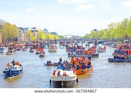 AMSTERDAM, NETHERLANDS - APR 27: People celebrating Kings Day in Amsterdam on April 27. 2015 in the Netherlands - stock photo