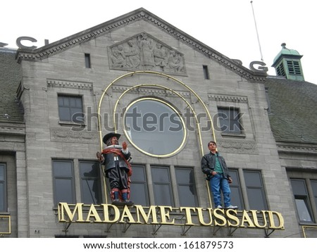 AMSTERDAM, NETHERLANDS - AUG 28: Madame Tussaud wax museum, as seen on August 28, 2008 in Amsterdam, Netherlands. It is a major tourist attraction in Amsterdam, displaying waxworks of famous figures. - stock photo