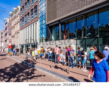 AMSTERDAM, NETHERLANDS - AUG 26: Visitors queuing in front of the Anne Frank House in Amsterdam, Netherlands on August 26, 2013. Amsterdam is the capital city of the Kingdom of the Netherlands. - stock photo