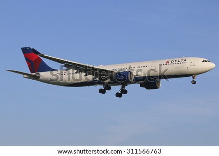 AMSTERDAM, NETHERLANDS - August 9, 2015: Delta Airlines, Airbus A330 aircraft landing at Schipol International Airport early morning, The Netherlands - stock photo