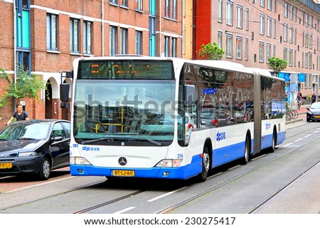 AMSTERDAM, NETHERLANDS - AUGUST 10, 2014: Modern articulated bus Mercedes-Benz O530 Citaro G at the city street. - stock photo