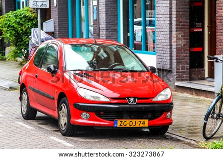 AMSTERDAM, NETHERLANDS - AUGUST 10, 2014: Motor car Peugeot 206 at the city street. - stock photo