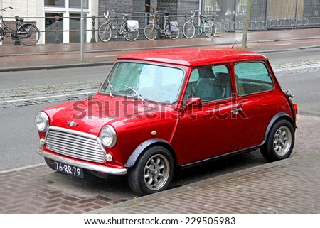 AMSTERDAM, NETHERLANDS - AUGUST 10, 2014: Retro car Austin Mini Cooper at the city street. - stock photo