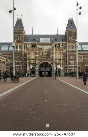 AMSTERDAM, NETHERLANDS - FEBRUARY 08: Visitor at Rijksmuseum exterior on February 08, 2015 in Amsterdam. The Rijksmuseum is located at the Museum Square, first opened its doors in 1885. - stock photo