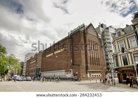 AMSTERDAM, NETHERLANDS,  JULY 13, 2012: The Heineken Experience, located in Amsterdam, is a historic brewery and corporate visitor center for internationally distributed Dutch pilsner, Heineken beer. - stock photo