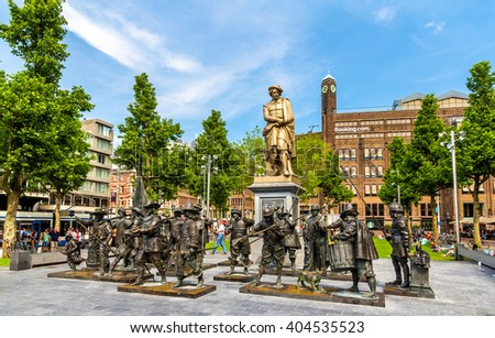 Amsterdam, Netherlands - June 9, 2014: Monument to Rembrandt and sculptures of his picture Night watch on Rembrandtplein Square. - stock photo