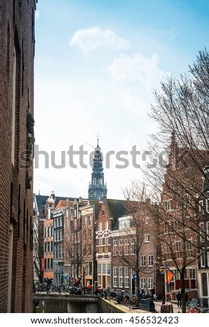 Amsterdam, Netherlands - March 31, 2016 : Beautiful street view of Traditional old buildings in Amsterdam, the Netherlands  - stock photo