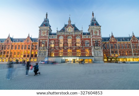 Amsterdam, Netherlands - May 8, 2015: Passenger at Amsterdam Central Train Station on May 8, 2015 in Amsterdam, Netherlands. Amsterdam Central Station is used by 250,000 passengers a day. - stock photo