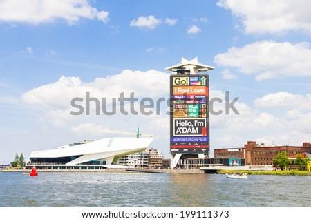 AMSTERDAM, NETHERLANDS - MAY 31 2014: The modern Eye Film Institute by the IJ harbour. The place was founded in 2010 and is a national museum with four cinemas and many other attractions. - stock photo