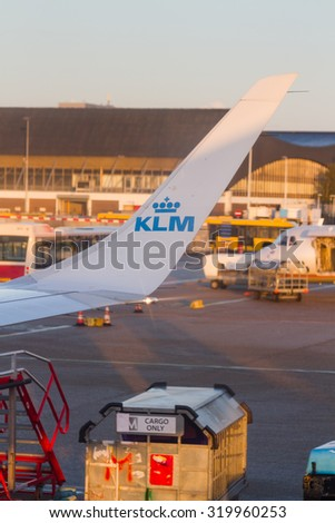 Amsterdam, Netherlands - Nov 9, 2014: KLM Plane at Schiphol Airport on November 9, 2014 in Amsterdam, Netherlands. The airport handles over 45 million passengers per year with almost 100 airlines. - stock photo