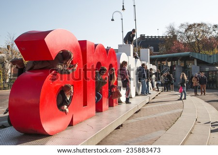 AMSTERDAM, NETHERLANDS - NOV 2014 - Tourists take photos amongst the I Amsterdam letters. Located at the back of the Rijksmuseum on Museumplein. - stock photo