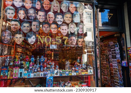 AMSTERDAM, NETHERLANDS - NOVEMBER 13: souvenir shop with celebrity masks on November 13, 2014 in Amsterdam. Amsterdam is capital of Netherlands and has more than 3.66 mio international visitors a year - stock photo