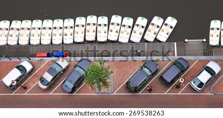 AMSTERDAM, NETHERLANDS, OCTOBER 06, 2014 : Amsterdam Old city canal parking top view, Netherlands  - stock photo