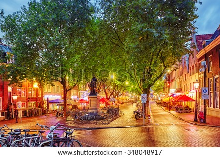 AMSTERDAM, NETHERLANDS-SEPTEMBER 15, 2015:Amsterdam city, Thorbecke statue in the evening time. - stock photo