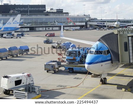 AMSTERDAM - OCT 6: KLM plane being loaded at Schiphol Airport on October 6, 2012 in Amsterdam, Netherlands. There are 163 destinations served by KLM, many are located in the Americas, Asia and Africa - stock photo