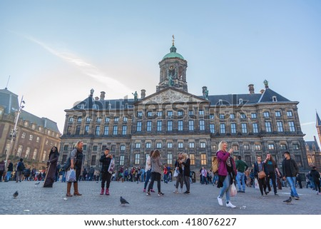 AMSTERDAM - OCTOBER 3: The front of Royal Palace at the Dam Square, Amsterdam, was built as city hall during the Dutch Golden Age in the seventeenth century, on October 3, 2015. - stock photo