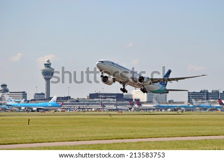 AMSTERDAM/SCHIPHOL, 27 AUGUST 2014 - Airplane from Garuda Indonesia departing from Amsterdam Airport Schiphol. - stock photo