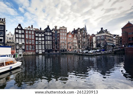 AMSTERDAM - SEPTEMBER 27, 2014: Romantic canal, boat. Urban landscape in Amsterdam, Netherlands - stock photo