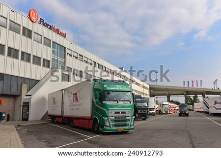 AMSTERDAM - SEPTEMBER 22: Trucks docked at Aalsmeer FloraHolland to load and unload flowers, taken on September 22, 2014 in Amsterdam, Netherlands - stock photo