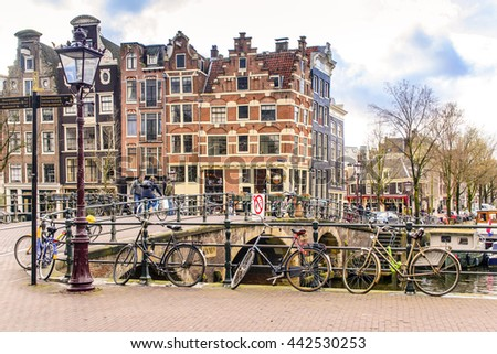 AMSTERDAM, THE NETHERLANDS- APRIL 7: Bicycle on the amsterdam brdige on April 7, 2016. Bicycles outnumber the people in Amsterdam, also there are twice as many bikes then cars. - stock photo
