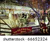 AMSTERDAM, THE NETHERLANDS - DEC 5: City natives and tourists visit Christmas fair Winterland held at Rembrandt Square, December 5, 2010 in Amsterdam, The Netherlands - stock photo