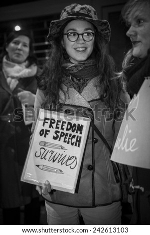 """Amsterdam, The Netherlands, January 8 2015: demonstation in solidarity with Charlie Hebdo in Paris, France on 07/01. Solidarity in all languages, woman holding a sign saying """"I am Charlie"""" - stock photo"""