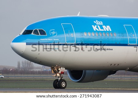AMSTERDAM, THE NETHERLANDS--17 JUNE 2014-- A KLM Airbus A330 passenger airplane is taxiing to the gate.  - stock photo