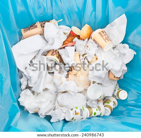 AMSTERDAM, THE NETHERLANDS - JUNE 29, 2013: Different kinds of waste gathered separately in waste containers for recycling during the Damn Food Waste day, food waste prevention initiative. - stock photo