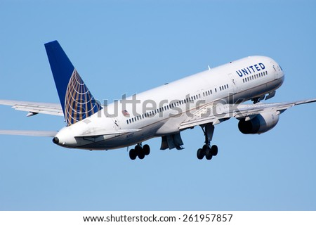 AMSTERDAM, THE NETHERLANDS--11 MARCH 2014-- A United Airlines Boeing 757 passenger airplane is taking off. - stock photo