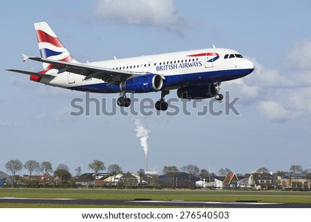 AMSTERDAM, THE NETHERLANDS - MAY, 7. An Airbus A319-131 of British Airways lands at Amsterdam Airport Schiphol (The Netherlands, AMS) on May 7, 2015. The name of the runway is Polderbaan. - stock photo