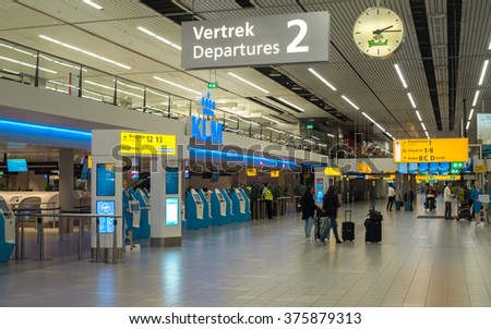 Amsterdam, The Netherlands - September 27, 2015: Check-in counters and Departures hall in Amsterdam Schiphol Airport (North Holland, The Netherlands). - stock photo