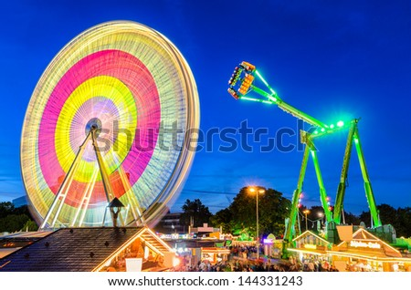 Amusement park at night at the marksmen festival in Hannover, Germany - stock photo