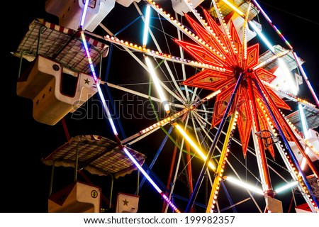 amusement park carousel, in the night - stock photo