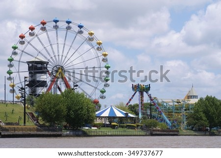 Amusement park on the banks of the Tigre River - stock photo