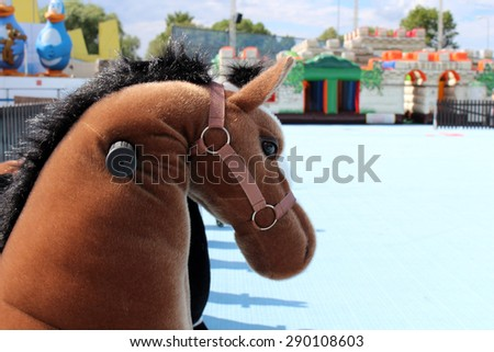Amusement park rides with horses for the children - stock photo