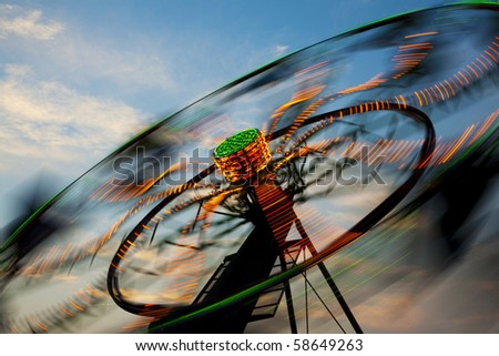 Amusement Rides with Movement Blur - stock photo
