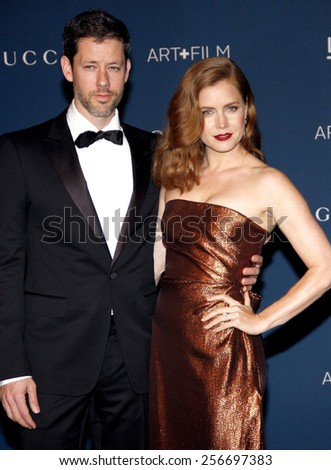 Amy Adams and  Darren Le Gallo at the LACMA 2013 Art + Film Gala Honoring Martin Scorsese And David Hockney held at the LACMA in Los Angeles on November 2, 2013 in Los Angeles, California.  - stock photo