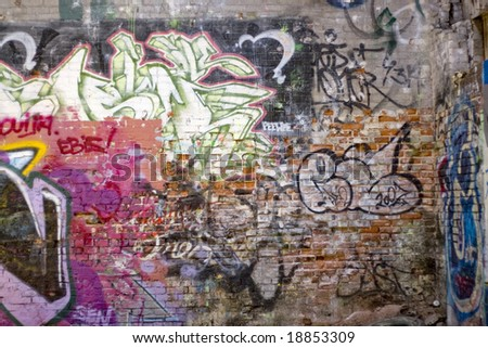 An abandoned area that is covered with graffiti.  This makes an excellent background or backdrop. - stock photo
