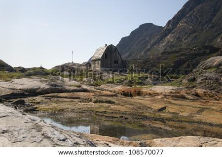 An abandoned barn near an old fishing spot in Illulisaat, Greenland. - stock photo