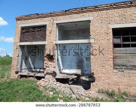 an abandoned brick building enterprise - stock photo