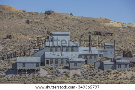 An abandoned old west silver mine in the Sierra Nevada mountains - stock photo