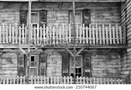 An Abandoned Rundown Farmhouse in Black and White - stock photo