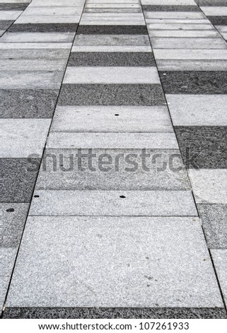 An abstract background image of a typical sidewalk or pavement. - stock photo