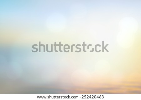 An abstract blurred ocean seascape. Sandy beach backdrop with turquoise water and bright sun light. Summer holidays concept. - stock photo