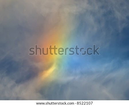 An abstract colored rainbow type cloud formation - stock photo