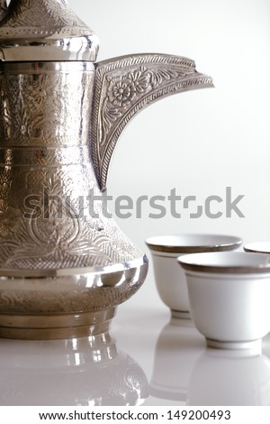 An abstract detail of a handle of a Dallah. A dallah is a metal pot with a long spout designed specifically for making Arabic coffee - stock photo