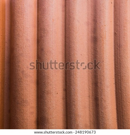 An abstract macro shot of the texture of the side of a terracotta pot. - stock photo
