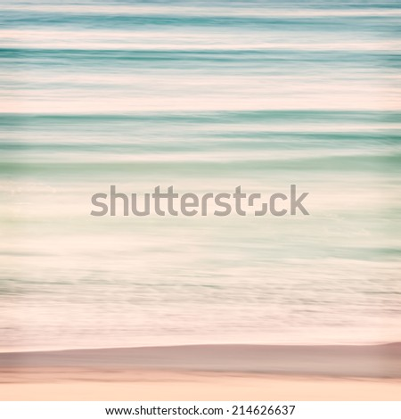 An abstract ocean seascape with blurred panning motion.  Image displays soft pastel colors with subtle cross-processing. - stock photo
