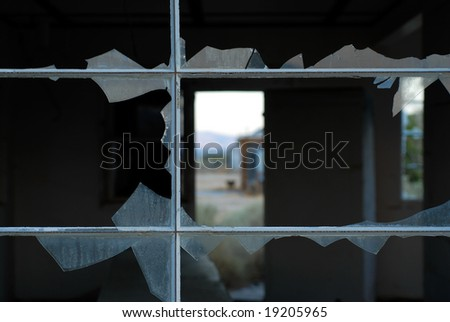 An abstract of a broken window - stock photo