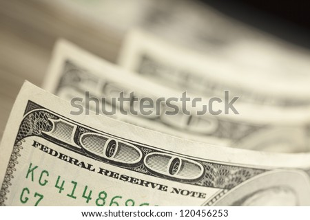 An Abstract of One Hundred Dollar Bills with Narrow Depth of Field. - stock photo